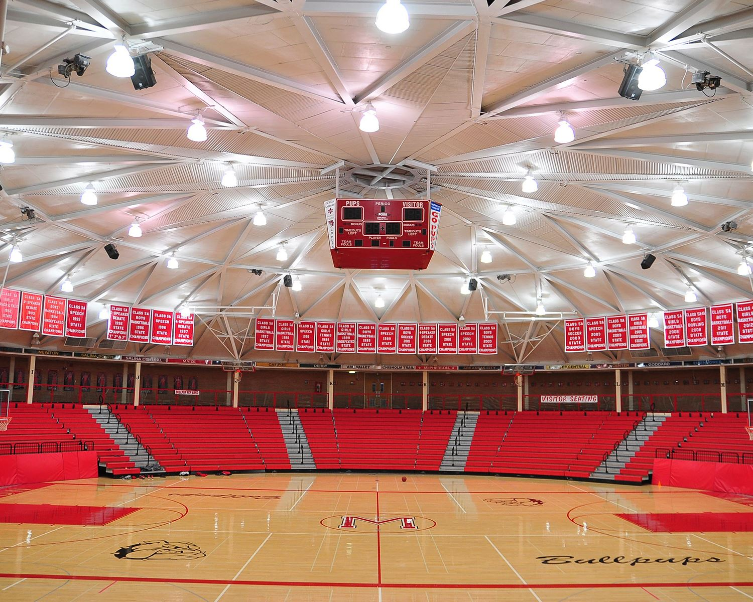 McPherson High School basketball court with red bleachers