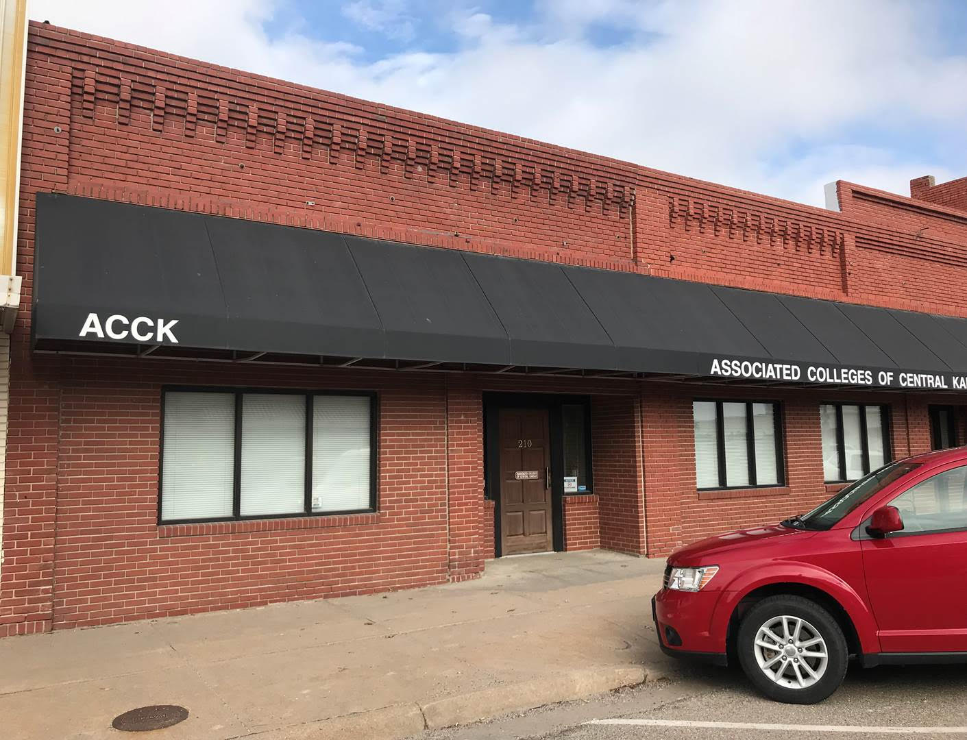 Exterior red brick building for rent